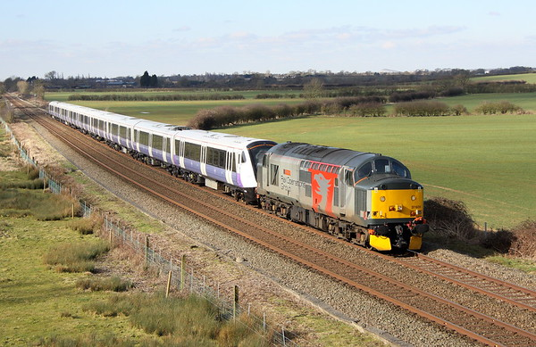 26 February 2018. With her British Steel blue days long behind her, 37601 Perseus bowls along at Husborne Crawley with 345019 in tow working the 0831 Wembley - Old Dalby. The working is seen here running 66 late due to the late arrival of 37601 into Wembley from Northampton.