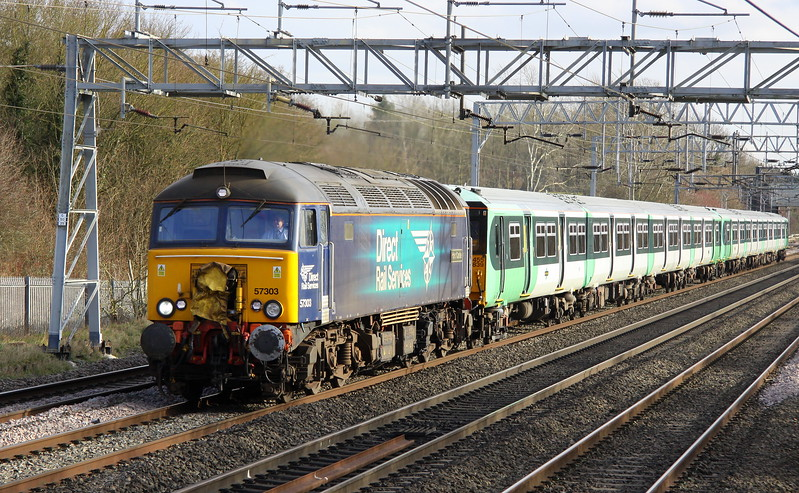 17 February 2018. 57303 Pride of Carlisle powers along the WCML at Bradwell on the last few hundred metres of her journey with Southern 455839 + 455831 in tow working the 5Q56 1140 Stewarts Lane T&RSMD - Wolverton Centre Sidings. The 455's are having door mods and other work undertaken at the Knorr Bremse site.