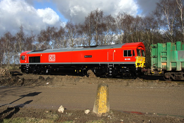 9 February 2018. In contrast to the filthy muddy road, a spotless 66035 Resourceful stands at Calvert during unloading of the 6M22 0855 ex Cricklewood binliner.