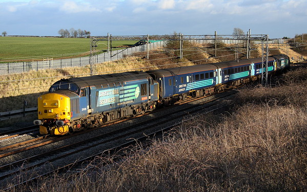 9 February 2018. With the shadows just playing ball 37419 Carl Haviland 1954-2012 tnt 37405 pass Castlethorpe with the 5Z37 1105 Norwich Crown Point - Crewe Gresty Bridge with three DRS mark 2 vehicles in the consist.