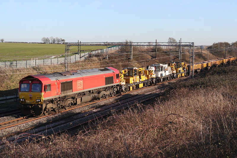 3 February 2019. DB red 66128 passes Castlethorpe leading he 7R01 1015 Apsley - Crewe Basford Hall engineers.