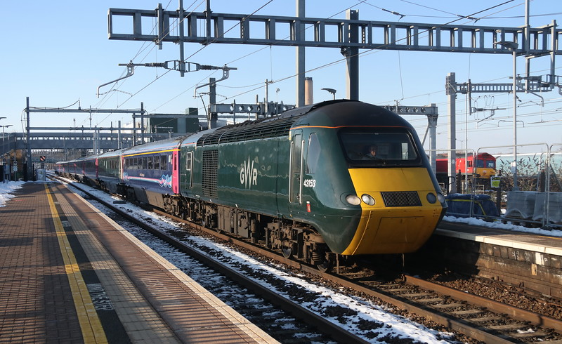 2 February 2019. With 66019 lurking in the background, 43153 arrives at Didcot with the 1L58 1316 Gloucester - Paddington.
