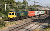 6 July 2018. 66953 takes a well loaded liner past Castlethorpe with the 4M93 1334 Felixstowe - Lawley Street.