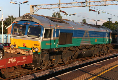 24 July 2018. Aggregate Industries liveried 66711 Sence catches the evening sun passing Wolverton leading the 6L48 1549 Garston - Dagenham.