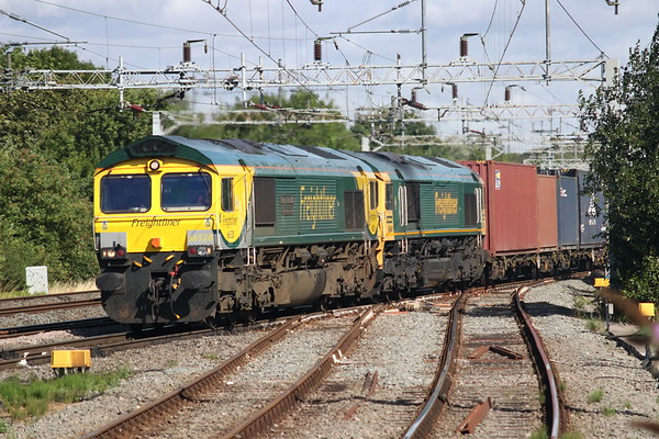 28 July 2018. Powerhaul 66528 Madge Elliot MBE Borders Railway Opening 2015 partners 66555 across Denbigh South Junction with the diverted 4O14 0738 Lawley Street - Southampton.