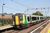 8 July 2018. With the former Royal Train shed to the left of photo, 350114 calls at Wolverton on a sunny Sunday morning with the 2Y97 0824 Euston - BNS.