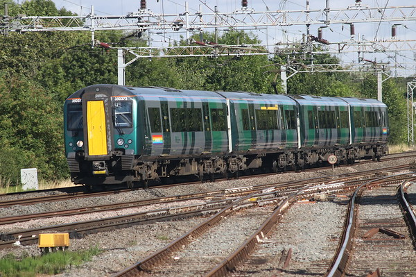 28 July 2018. The only 350 to carry LNWR livery now also sports additional branding in the form of #Pride 2018 on the bodysides of the end vehicles. 350373 is seen working the 1U20 0718 Crewe - Euston passing Denbigh South Junction.