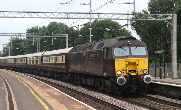 2 June 2018. An overcast sky sees 57313 pass Wolverton on the Northern Belle, the 1Z67 0552 Manchester Victoria - Leatherhead.