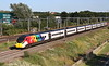 22 June 2018. Pendolino Pride as rainbow adorned 390045 Virgin Pride approaches MK at speed with the 9G35 1723 Euston - BNS.