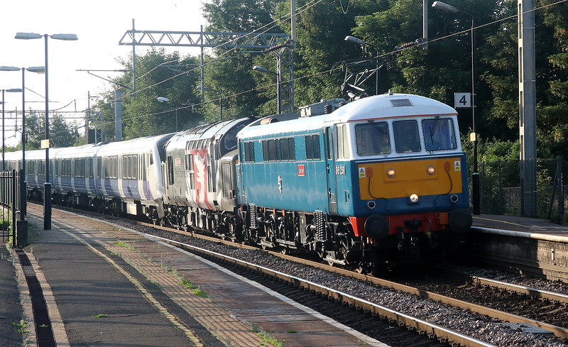 11 June 2018. Evening sun glistens on the side of 86259 Les Ross as she passes Wolverton with failed 37800 Cassiopeia tucked in behind and Elizabeth Line 345035 on the rear of the 1110 Crewe CS - Old Oak Common. 37800 left Crewe with 345035 266 late before the tractor was declared a failure at Rugby with 86259 being summoned to rescue the service.