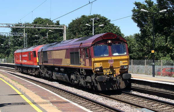 29 June 2018. DB stickered 66108 partners 2015 passing Wolverton on the 1120 Crewe Electric Depot - Willesden 'F' Sidings.
