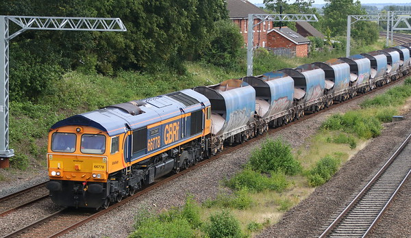 23 June 2018. Electrification is coming to the MML. 66778 Darius Cheskin passes Oakley with the 6M59 1315 Purley Yard - Bardon Hill.