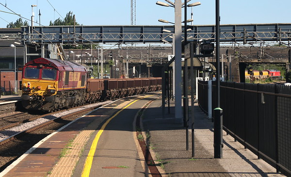 30 June 2018. With DB red 66165 leading the way in the distance, 66056 brings up the rear of the 6R01 1458 Bescot - Wembley at Wolverton.
