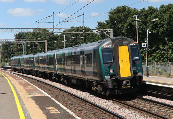 30 June 2018. 350373 pulls into Wolverton with the 1Y40 1214 BNS - Euston.