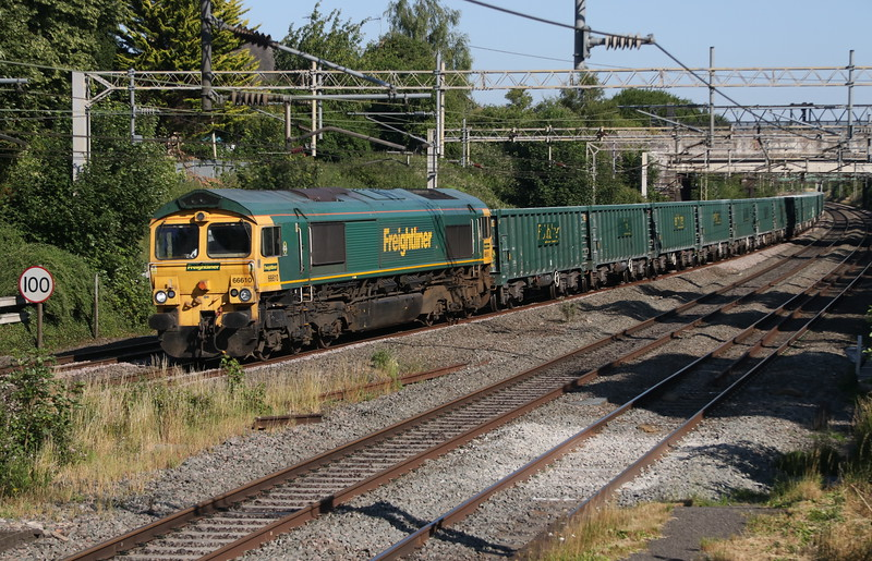 29 June 2018. Freightliner uniformity as 66610 approaches the former derelict station platforms at Castlethorpe working the 6M80 1502 Bow - Guide Bridge.