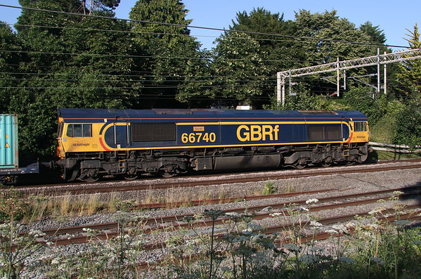 29 June 2018. A broadside view of GBRf 66740 Sarah passing Castlethorpe with the 4L18 1412 Trafford Park - Felixstowe.