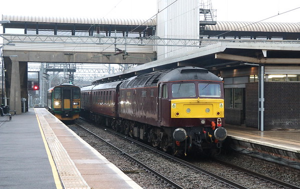 24 March 2018. Recently reactivated and named 47772 Carnforth TMD brings up the rear of The Sussex Salopian' at Bletchley. The former Sir Gwynedd County of Gwynedd can been seen at Bletchley in her earlier guise over 17 years ago here https://mark-beal-tmd.smugmug.com/RetrospectiveRail/Retrospective-Class-47/i-d35hbd7
