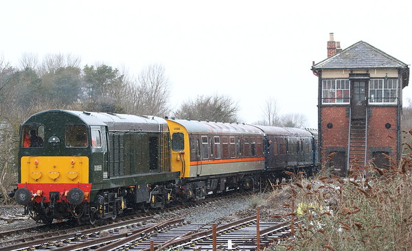 17 March 2018. A colourful cavalcade as BR green class 20, D8059 brings up the rear of the 1C48 1340 Princes Risborough - Chinnor. Also in the consist is 3 Cep 1198 Linda The Lymington Flyer, one vehicle being painted in the long lost 'Jaffa Cake' livery