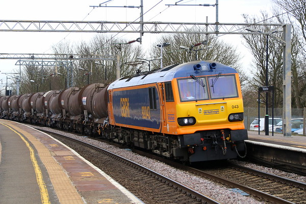 9 March 2018. A smart recently repainted 92043 hauls a heavily delayed 6M74 1950 Irvine Caledonian Paper - Wembley 'China Clays' through Wolverton. The service was delayed in the Crewe area and is seen here running a mere 406 minutes late.