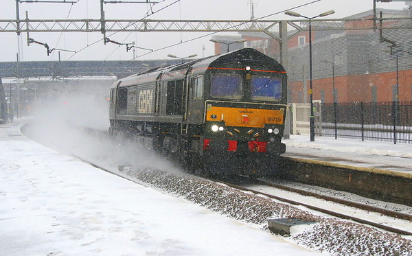 2 February 2018. The Beast from the East, well Felixstowe actually sees 66779 EVENING STAR creating her own snowstorm passing Wolverton atop the 4M23 1046 Felixstowe - Hams Hall.