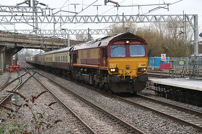 17 March 2018. With sister 66111 on the rear, 66110 passes under Bletchley flyover working 'The Missing Link', the 1Z17 0810 Euston - Quainton Road.