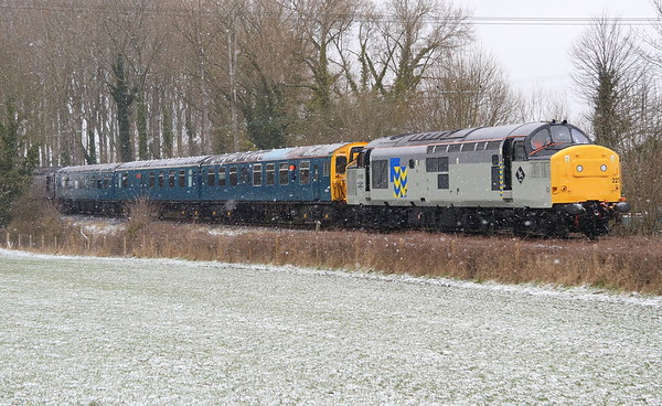 17 March 2018. Feel the chill as a smart 37227 + 3 CEP 1198 Linda The Lymington Flyer + 33207 Jim Martin head past a snowy and bitterly cold Bledlow Village Cricket Club during the Chinnor Diesel Gala. The 37 is working the late running 1P23 1100 Chinnor - Princes Risborough.