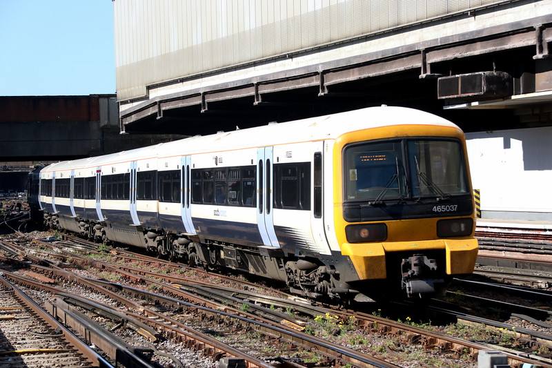 5 May 2018. 465037 is caught between shadows at London Victoria with the 2K62 0752 from Dover Priory.