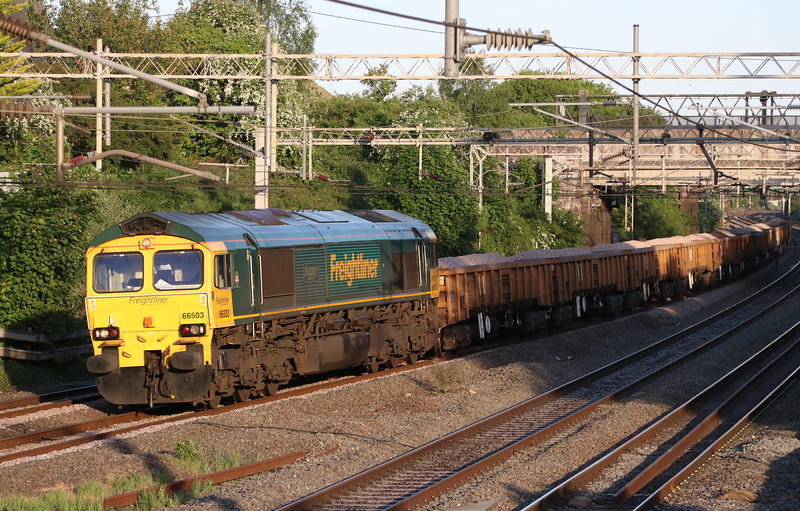 19 May 2018. Having run round at Bletchley, 66503 The RAILWAY MAGAZINE heads North past the former station at Castlethorpe working the 6Y58 1418 Crewe BH - Long Buckby.