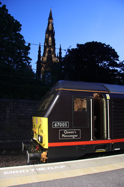18 May 2018. 67005 stands at Edinburgh Waverley with the Scott Monument dedicated to Sir Walter Scott acting as a backdrop. Edinburgh Waverley is named after Scott's Waverley novels.