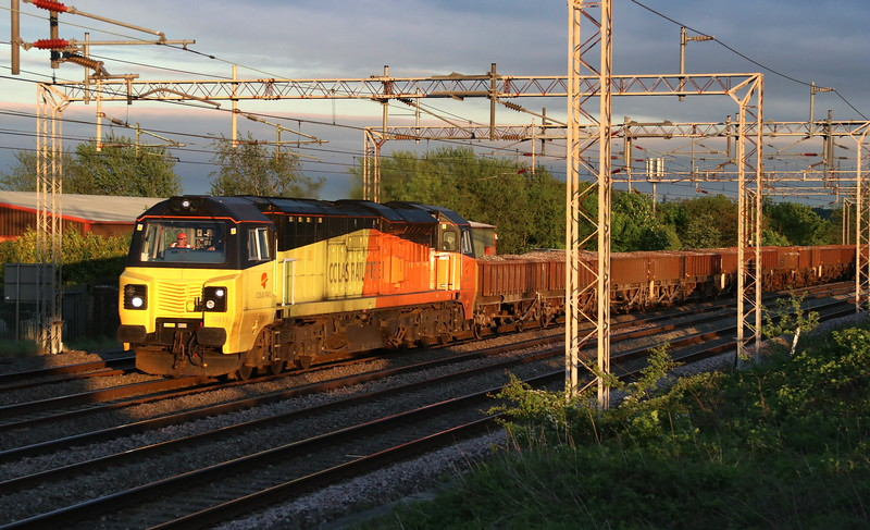 8 May 2018. Having resided in Wembley Yard for three days, Colas 70811 heads past Lodge Farm, Castlethorpe with the 6C23 1847 Wembley Yard - Bescot. Five seconds earlier and the 70 would have passed in full gloom.