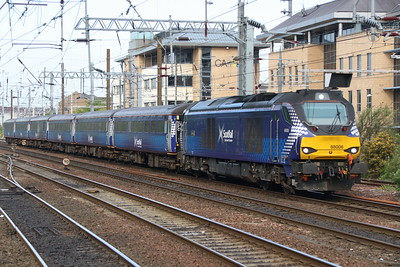 18 May 2018. 68006 Daring slows for the Haymarket stop with the 2K18 0737 Cardenden - Edinburgh via Dunfermline.