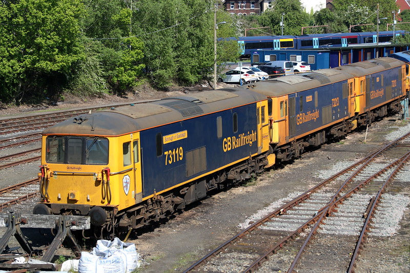 5 May 2018. Presently stored and used on an as required basis, 73119 Borough of Eastleigh sits silently with 73213 Rhodalyn + 73212 Fiona on the blocks in Tonbridge Yard.
