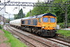 18 May 2018. 66733 Cambridge PSB passes Dalmuir with the 6E45 0807 Fort William - North Blyth alumina empties.