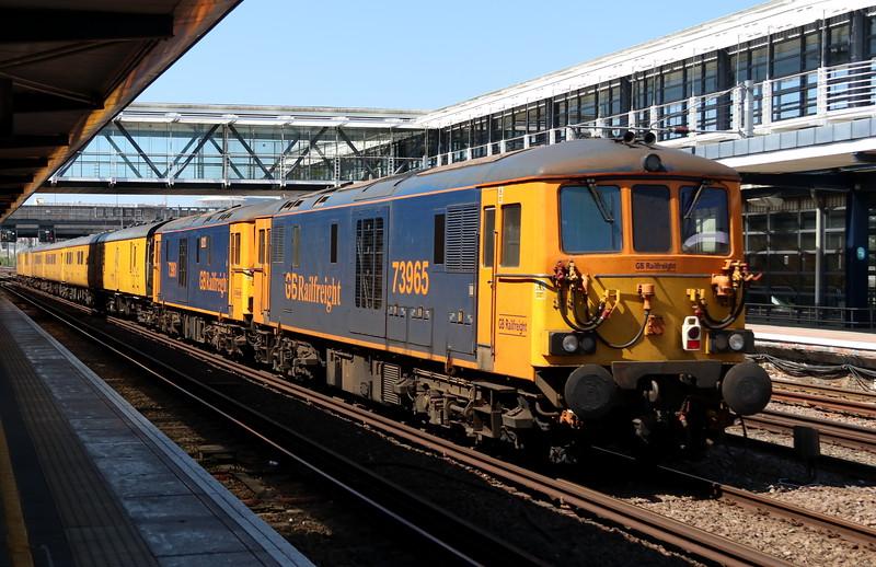 5 May 2018. 73961 Alison + 73965 tail the 1Q80 1341 Dollands Moor - Derby RTC test train through Ashford International.