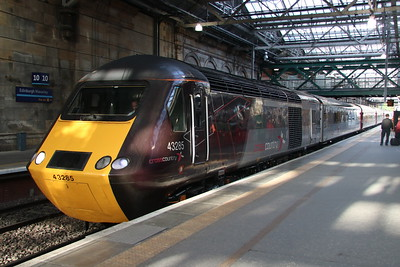 18 May 2018. With the sun penetrating the glass roof at Edinburgh, 43285 calls for custom with the 1V52 0601 Glasgow Central - Plymouth.