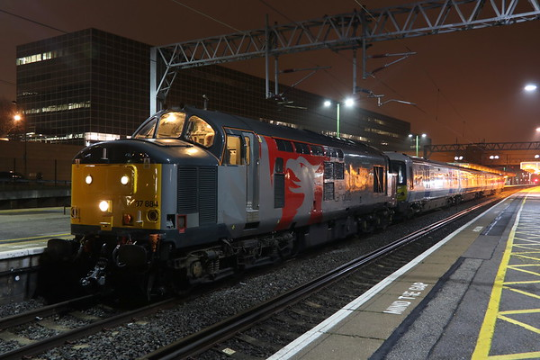 27 November 2018. 37884 Cepheus + 365505 are held by a red in platform 2 at MK whilst working the 5Q42 2348 Ilford EMU Depot - Crewe South Yard.