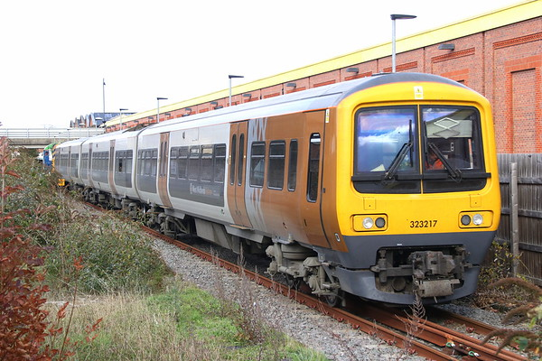 3 November 2018. 323217 is seen being towed along McConnell Drive in Wolverton by works resident 08629 Wolverton. The 323 had arrived as the 0857 Soho LMD - Wolverton Centre Sidings.