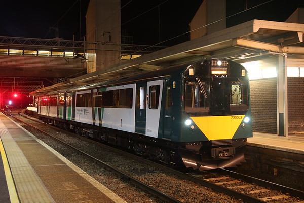 9 October 2018. And so it begins. Testing of the 'new' traction for the Marston Vale line has commenced. Vivarail 230003 comprises former London Underground vehicles 7069 now numbered 300003 and 7127 now numbered 300103. Carrying Marston Vale branding, 230003 stands at Bletchley on test working 5Q35 2035 Bedford -Bletchley TMD.