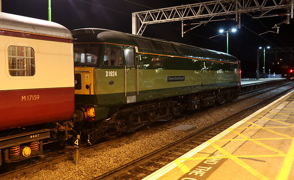 27 October 2018. D1924 Crewe Diesel Depot stands in the crisp night time air at MK having arrived on the rear of 5Z22. This loco has now carried four different names having previously been named Porterbrook, Captain Sensible and Peter Bath MBE 1927-2006 before gaining her latest plates.