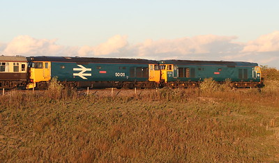 23 September 2018. 50007 masquerading as 50006 Neptune and 50049 masquerading as 50011 Centurion pass Bicester South Junction at caution leading the GBRf Out of the Ordinary, Day 4, the 1Z44 1500 Crewe - Paddington.