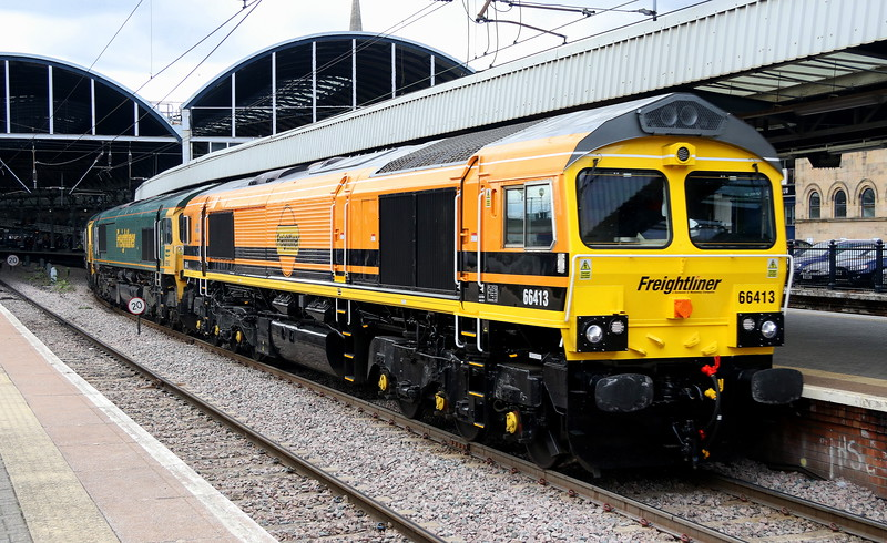 15 September 2018. Recent repaint 66413 brightens up a grey Tyneside afternoon leading 66602 + 66539 + 66542 through Newcastle with the 1120 Leeds Midland Road - Millerhill. 66539 + 66542 were later used on an engineers working from Millerhill to Kittybrewster near Aberdeen.