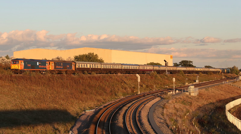 23 September 2018. The low setting sun captures 73107 Tracy + 73141 Charlotte passing Bicester South Junction on the rear of the GBRF Out of the Ordinary charter, Day 4, the 1Z44 1500 Crewe - Paddington.
