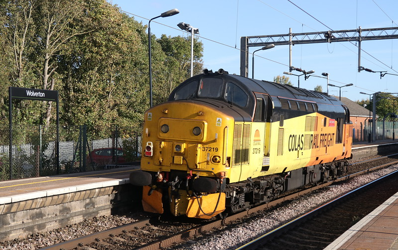 28 September 2018. Colas beast 37219 Jonty Jarvis 8-12-1998 to 18-3-2005 passes light through Wolverton running as 0Z37 1355 Crewe Basford Hall - Hither Green.