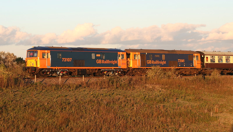 23 September 2018. Shoeboxes at sunset as 73107 Tracy + 73141 Charlotte bring up the rear of 1Z44 1500 Crewe - Paddington at Bicester South Junction.