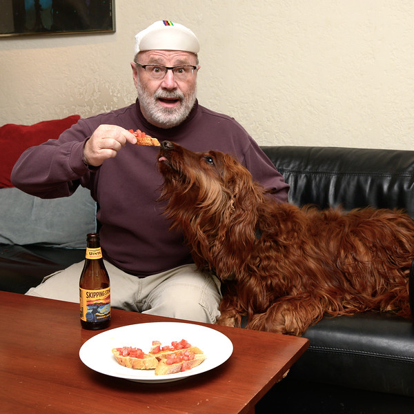 in honor of  the Giro d'Italia  cycling race - I'm wearing my favorite Italian cycling cap and eating Bruschetta! And since the race started out in Ireland this year, my Irish Setter is helping out.