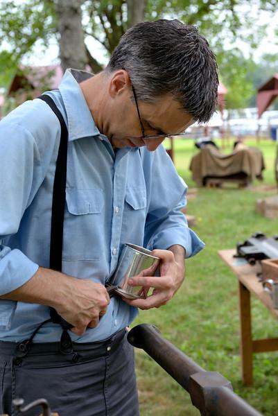 Tinker Working Tinware