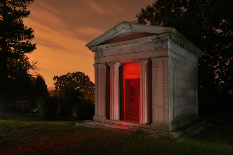 Rose mausoleum with light-painted door