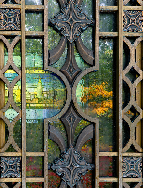 Door of Helmsley mausoleum with back wall stained-glass window of Manhattan skyline and autumn reflection