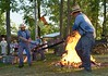 Wheelwrights Removing Iron Rim From Fire