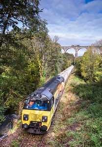 121017.  70808 sits at Coombe waiting to depart with the  6C36  ThO  11:38 Moorswater-Aberthaw cement works,whilst crossing Moorswater viaduct is  66850 0C08 09:25 Penzance to Tavistock Jn (running with Rila test gear)